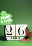 Plant a Tree on Arbor Day with white block calendar for April 26 - vertical with copy space. Arbor Day, plant a tree on April 26 with white block calendar, tree royalty free stock photos