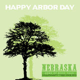 Arbor Day. Silhouette of a big tree on a  green background with the text Happy Arbor day Royalty Free Stock Photo