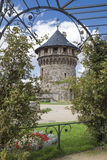 Arbor with flowers and watchtower of the castle ramparts Stock Photo