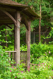 Arbor in garden. Wooden arbor in summer garden Stock Photos