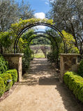 Arbor leads you to the vineyards. Inviting garden arbor, upscale winery Royalty Free Stock Photo
