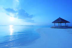 Arbor on Maldives beach. The arbor on beach in the sunrise Royalty Free Stock Image