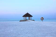 Arbor on Maldives beach sunrise. The arbor on beautiful beach at Maldives Stock Photo