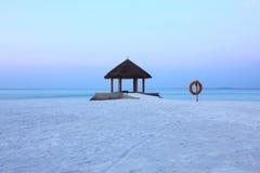 Arbor on Maldives beach sunrise Stock Photo