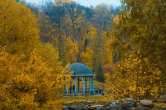 Arbor standing in the autumn park. Arbor in the middle of the autumn park Royalty Free Stock Photos