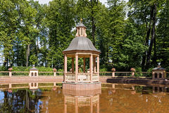Arbor in middle of pond. In summer park Royalty Free Stock Images