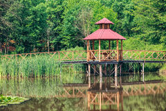 Arbor over the lake. In the Carpathians Royalty Free Stock Images