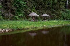 Arbor on the river near the forest. Stock Photos
