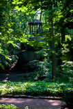 Arbor on the rocks. In the green summer forest cool Stock Image