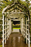 Arbor Into Rose Garden. A wooden arbor leading into a rose garden Stock Photo
