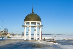 Arbor-rotunda on the embankment of Onega lake, February day. Petrozavodsk, Russia. Arbor-rotunda on the embankment of Onega lake on a sunny February day stock photo