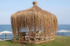 Arbor at the seaside. Arbor with thatched roof at the seaside Stock Photography