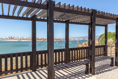 Arbor for shade, on the beach of the city of Portimao. Portugal Royalty Free Stock Photos