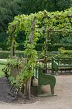 Arbor shading garden benches Royalty Free Stock Images