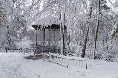 Arbor in the snowy park Stock Images