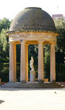 Arbor with statue of the labyrinth gardens of Horta Royalty Free Stock Photos