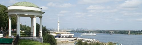 Arbor on the waterfront and the river station of the city of Yaroslavl. Cruising ship sailing. Bridges over the river Volga royalty free stock photography
