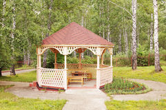 Arbor in a wood. Wooden painted arbor in a forest Royalty Free Stock Photo