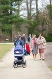 Arboretum park footpath. KORNIK, POLAND - MARCH 22, 2014: People walking on a footpath at the arboretum park Stock Images
