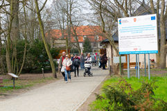 Arboretum park footpath. KORNIK, POLAND - MARCH 22, 2014: People walking on a footpath at the arboretum park Royalty Free Stock Image