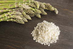 Arborio and green asparagus Stock Photos