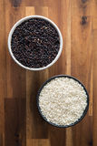 Arborio and nerone rice. Arborio and nerone rice in bowl. Top view Stock Photo