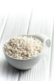 Arborio rice. The uncooked arborio rice in bowl Stock Image