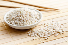Arborio rice. The uncooked arborio rice in bowl Royalty Free Stock Image