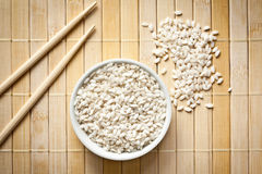 Arborio rice. The uncooked arborio rice in bowl Stock Photo