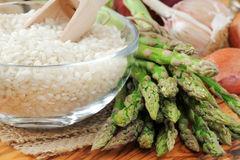 Arborio rice and asparagus. Ingredients for Italian risotto with fresh asparagus Royalty Free Stock Photos
