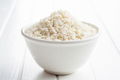 The arborio rice. The arborio rice in bowl on white table Stock Images