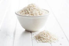 The arborio rice. The arborio rice in bowl on white table Royalty Free Stock Photography