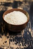 Arborio rice in a brown bowl Royalty Free Stock Photography