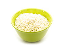 Arborio rice. In green bowl  on white background Royalty Free Stock Photos