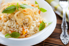 Arborio rice with onions in a white bowl. Closeup Royalty Free Stock Photo