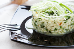 Arborio rice with spinach and onions. Closeup Stock Images