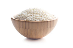 The arborio rice. The arborio rice in wooden bowl. Isolated on white background Stock Photo