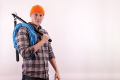 An arborist with a lopper and a rope over his shoulder royalty free stock images