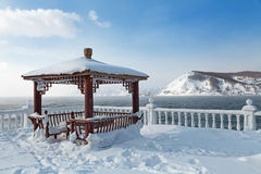 Arbour. Summer arbour on the shore of lake Baikal at the source of the river Angara, a winter landscape, Siberia, Russia Stock Image