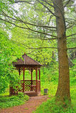 An arbour in Dendrology garden in Pereslavl-Zalessky city. In Dendrology garden of S. F. Kharitonov in Pereslavl-Zalessky city, Yaroslavl region, Russia Stock Photos