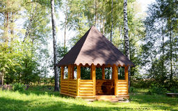 Arbour in the forest. This arbour is a nice place for rest in a forest Royalty Free Stock Photo