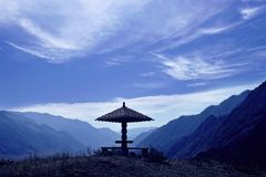 Arbour in mountains. Blue sky Royalty Free Stock Photos