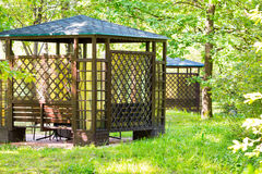 Arbour in the park. Comfortable arbour in the park green forest Stock Image