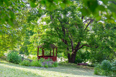 Arbour in the park. Comfortable arbour in the park green forest Royalty Free Stock Images