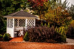 Arbour in the park. View of white arbour in the park Royalty Free Stock Images