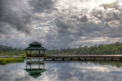 Arbour with pathway  on the lake. Arbour with pathway on the lake with dark clouds Royalty Free Stock Photo