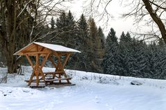 Arbour for relaxing. On the edge of the winter forest Royalty Free Stock Images