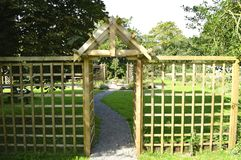 Arbour and trellis timber screen. In a garden Stock Photo