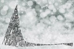 Arbre avec le Joyeux Noël dans diverses langues, Gray Snow Background illustration libre de droits
