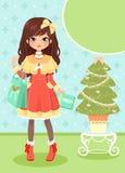 Arbre de fille et de Noël Photographie stock